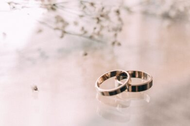two-silver-colored-rings-on-beige-surface-818649