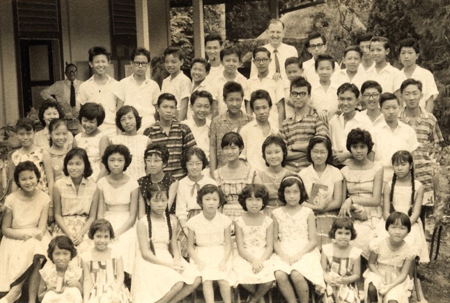 The King's Youth Group, with Rev Henry Khoo beaming in the background (top left)