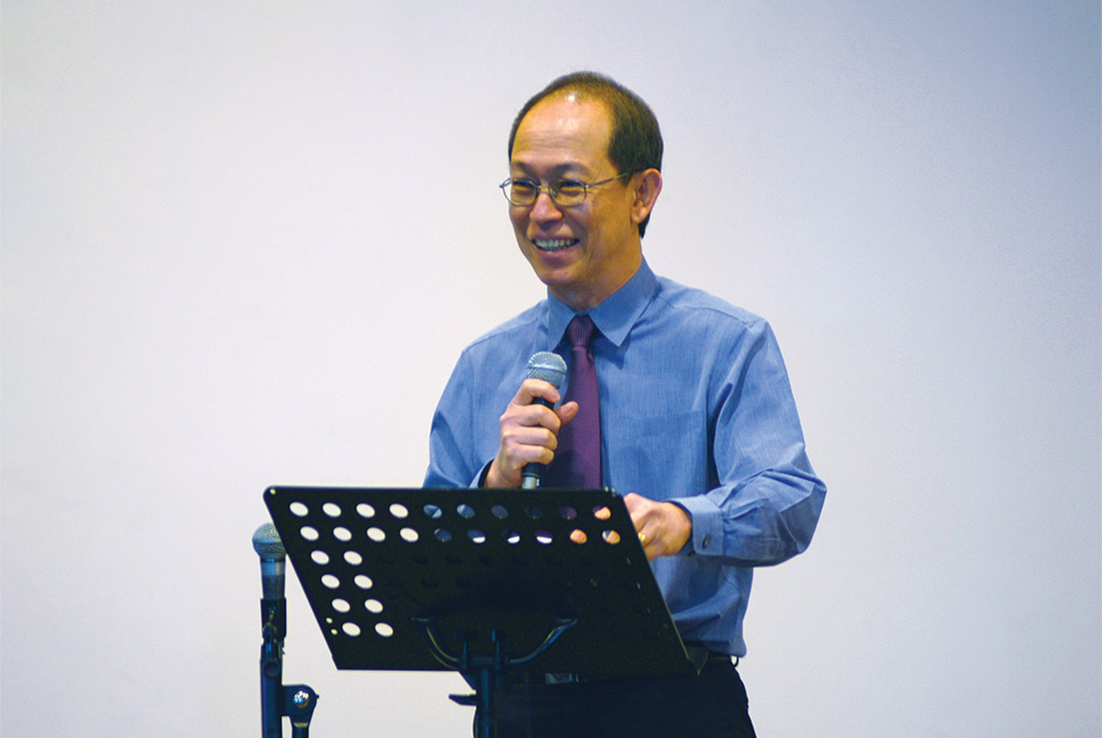 Rev Kenny preaching at our first official Mandarin service on 5 August 2007