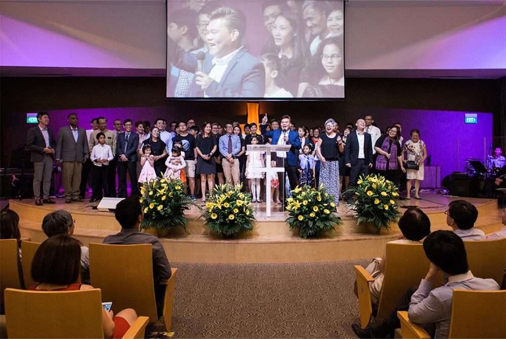 Families and volunteers from our New Life Group stand as witnesses to God's amazing grace in this 2017 picture, taken during our 10th year celebration of the Prison Ministry in WEFC